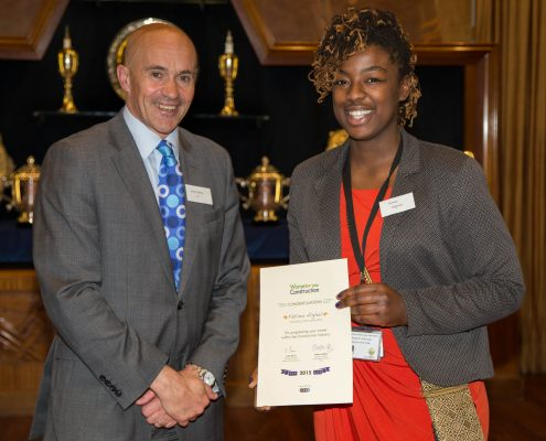 Fatima receives her career award from Adrian Belton of the CITB