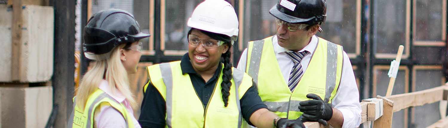 Two women on construction site with male colleague