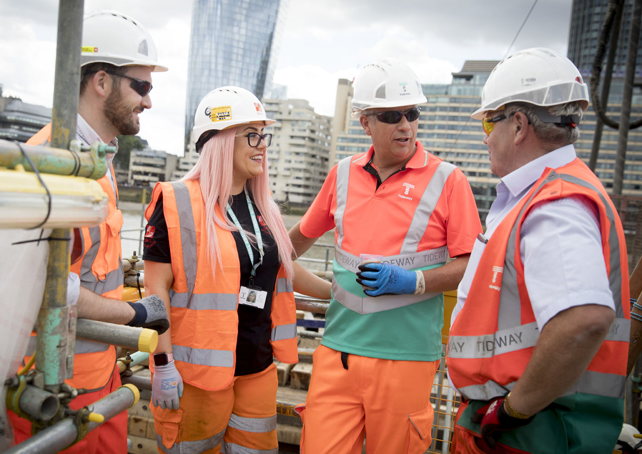 Woman construction worker with male colleagues on Tideway site