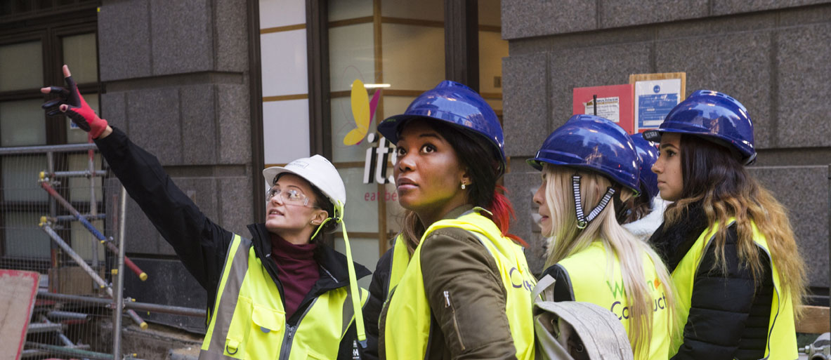 Four women workers on construction site